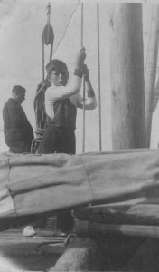Gino Cucco while lifting the sail on his barge